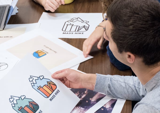 Scout student presents logo variations to their client.