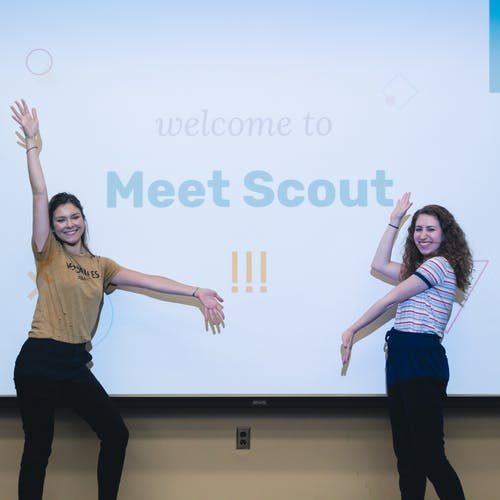 Two members of Scout's management team give a presentation about the organization.