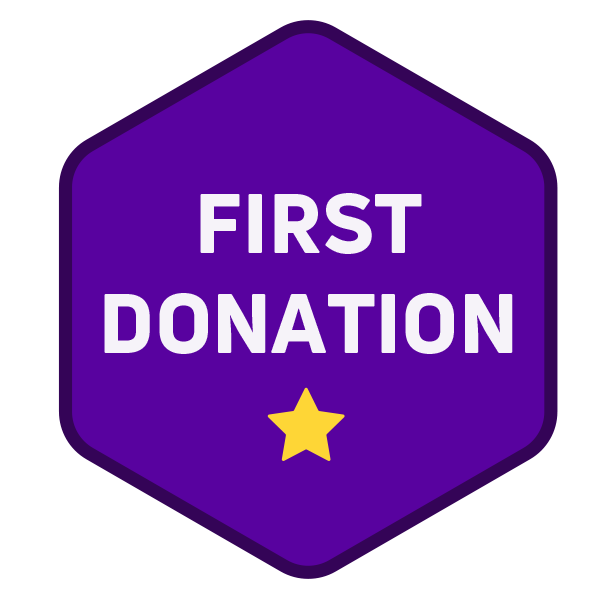 Hexagon purple badge with the text 'First Donation' on followed by a small yellow star