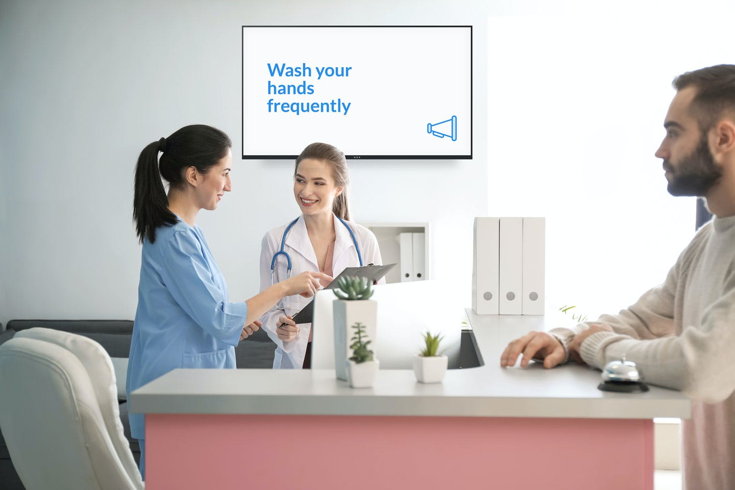 hospital reception with wash your hands sign