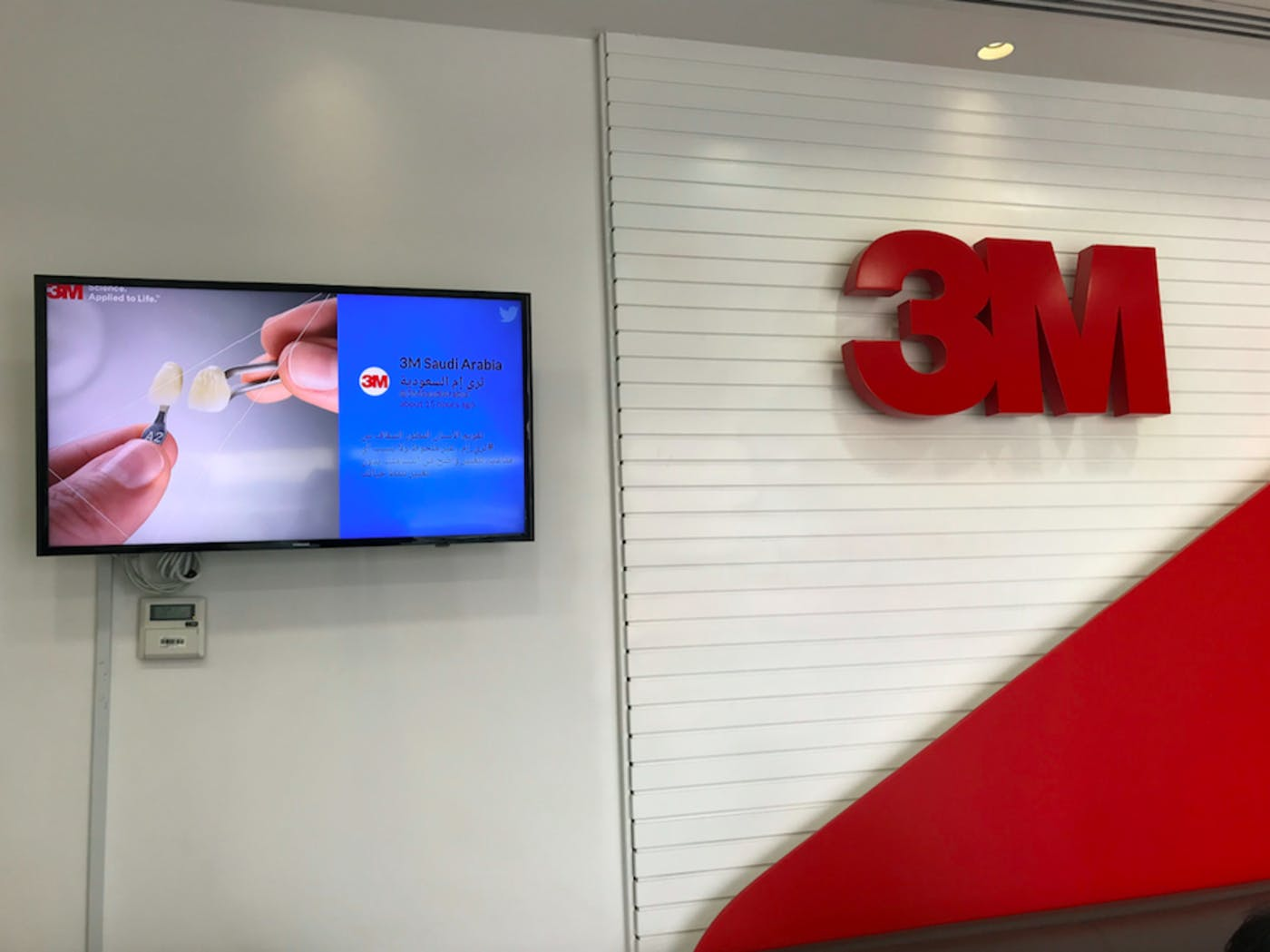 office wall with digital signage screen