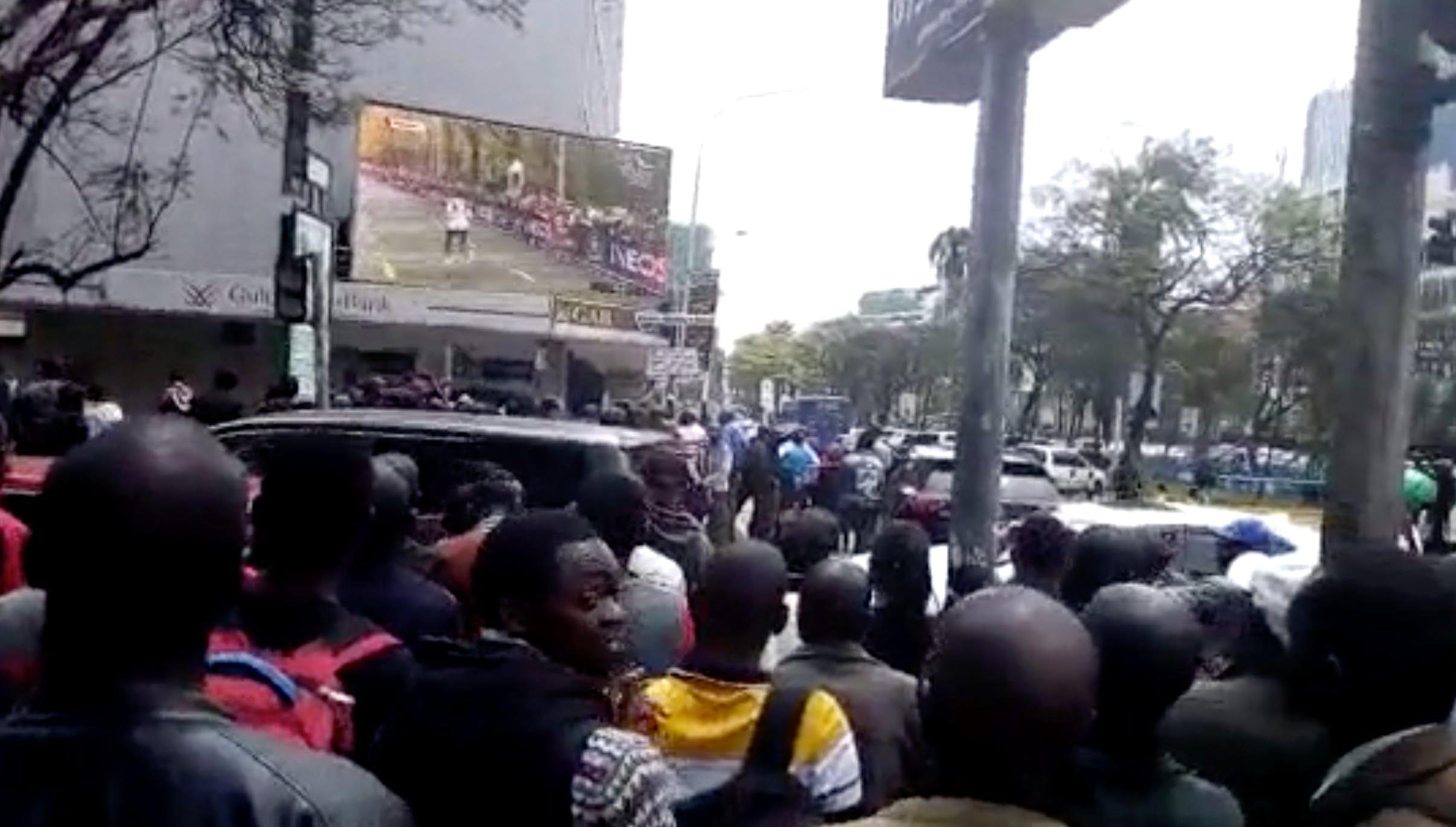 people watching outdoor screen