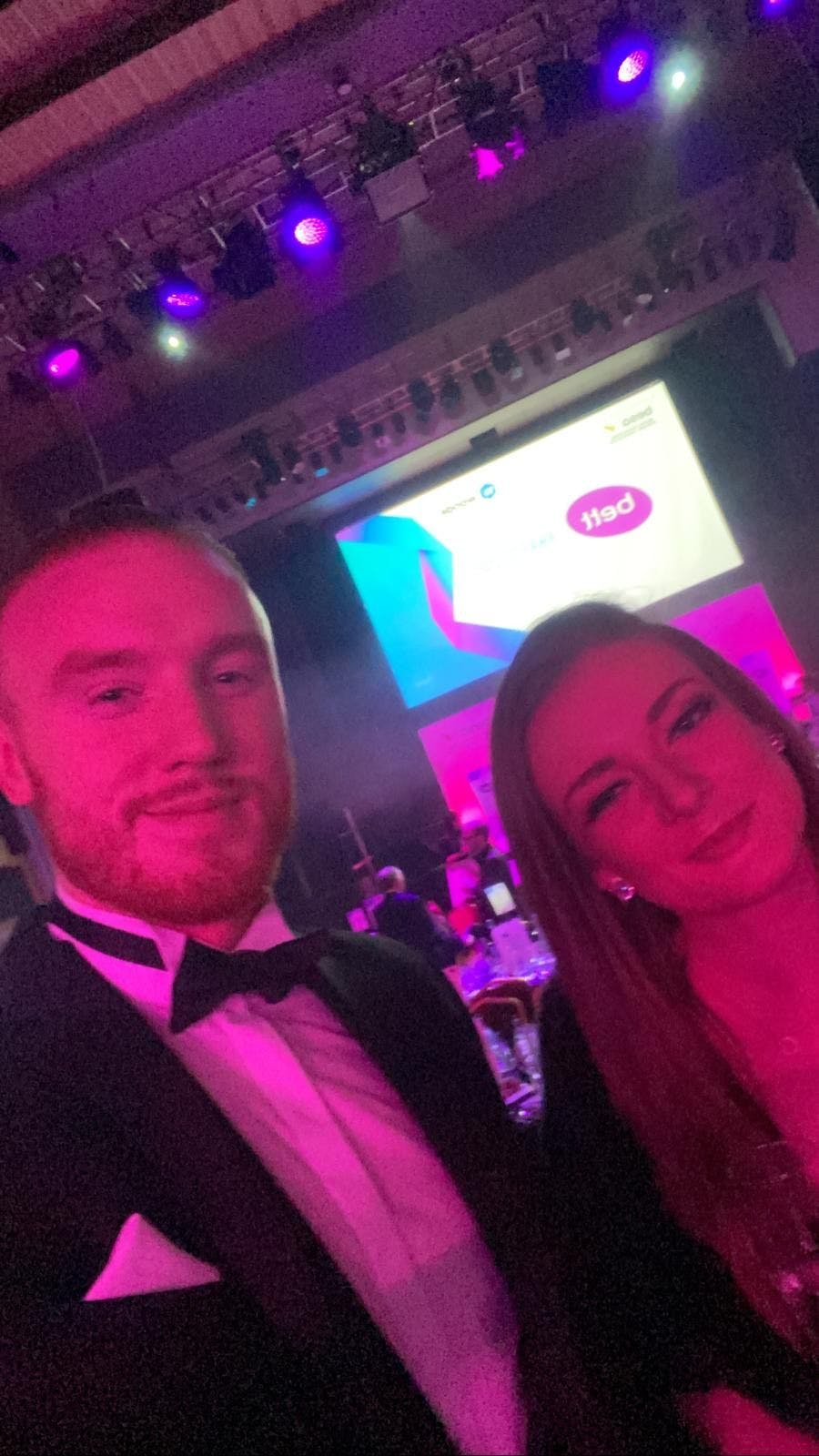 Photo by the SCR tracker team of Co Founder Luke O'Dwyer and Head of Business Development Julia Nielsen at Troxy London Bett Awards Show 2020 where single central record register online software wins highly commended in leadership and management solutions judges commented excellent entrepreneur entrepreneurial spirit and successful safeguarding of students education educational organisations institutions black tie event award-winning