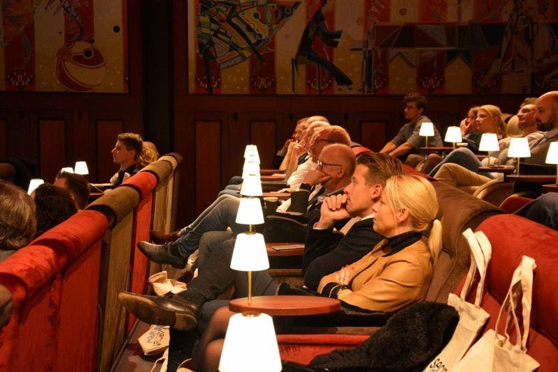Guests looking at the presentations at secret views client day