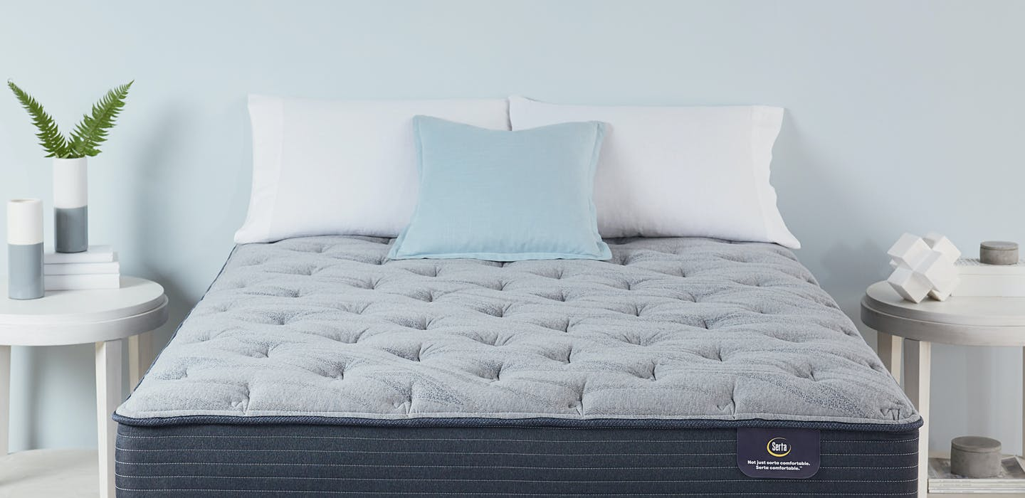 A Serta Luxe mattress in a bedroom.