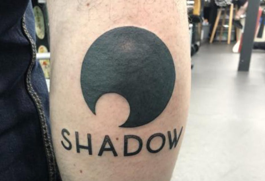 Here is something really crazy! One of our community members tattooed our logo on his calf!