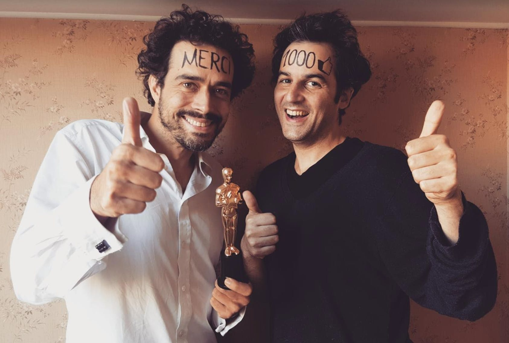 Here, 2 of our 3 co-founders are happy about our first 1000 Facebook likes. On the left: Stéphane Heliot. On the right: Emmanuel Freund. Good job Acher Kagan for escaping this embarrassing (but absolutely beautiful) picture.