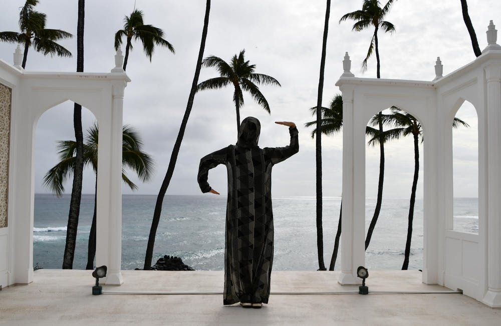 Dancer Amirah Sackett posing on the roof/Jali Pavillion at Shangri La, overlooking the ocean.
