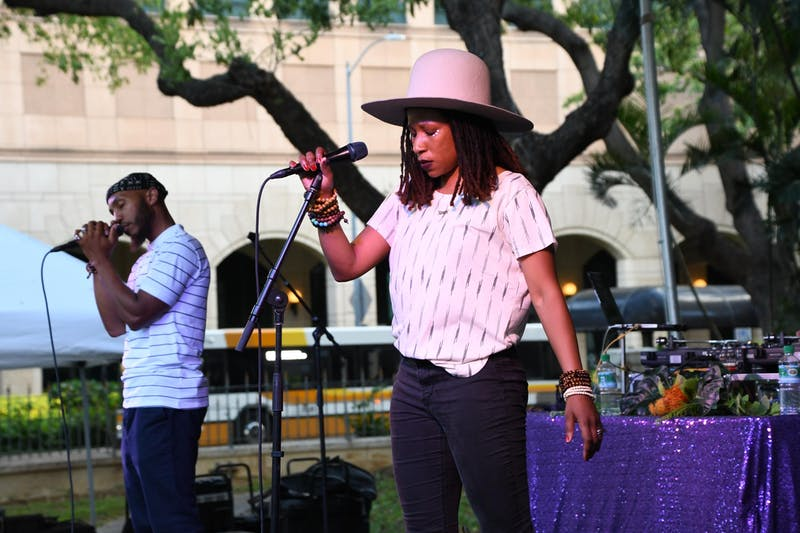 The Reminders, Big Samir and Aja Black, performing on stage at the Hawaii State Art Museum.