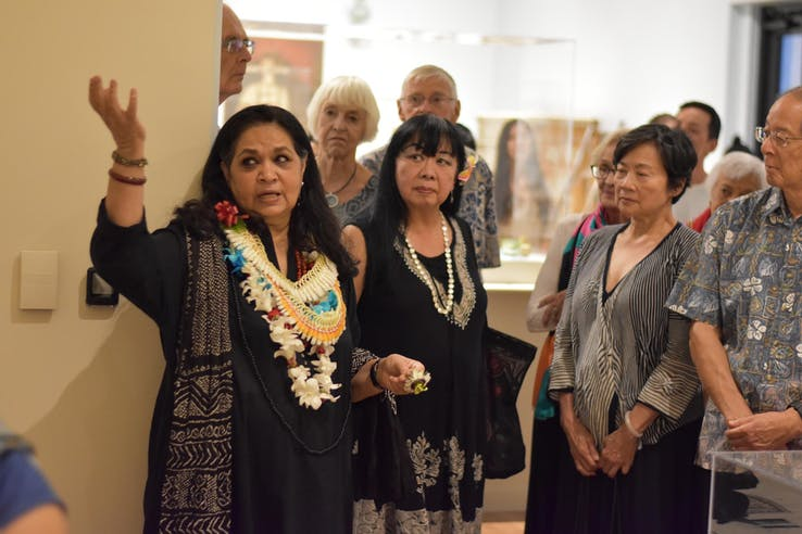 Noorjehan Bilgrami talking to guests during the opening for her exhibition, Under the Molsri Tree, at the Honolulu Museum of Art.