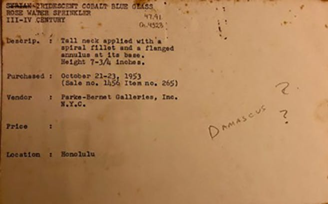 """Shangri La archival object notecard with text from Kelekian's 1953 auction sale catalogue, attributing the sprinkler to Syria. An early guess of its provenience is seen in the handwritten note reading """"Damascus?"""", which recent research has revealed to be inaccurate."""