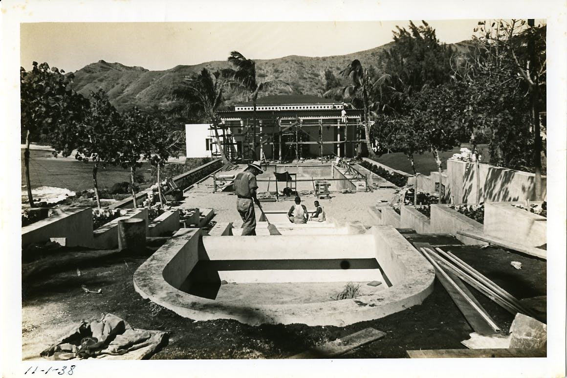 Historic photo of construction being performed on the cascade water feature of the Shangri La property.