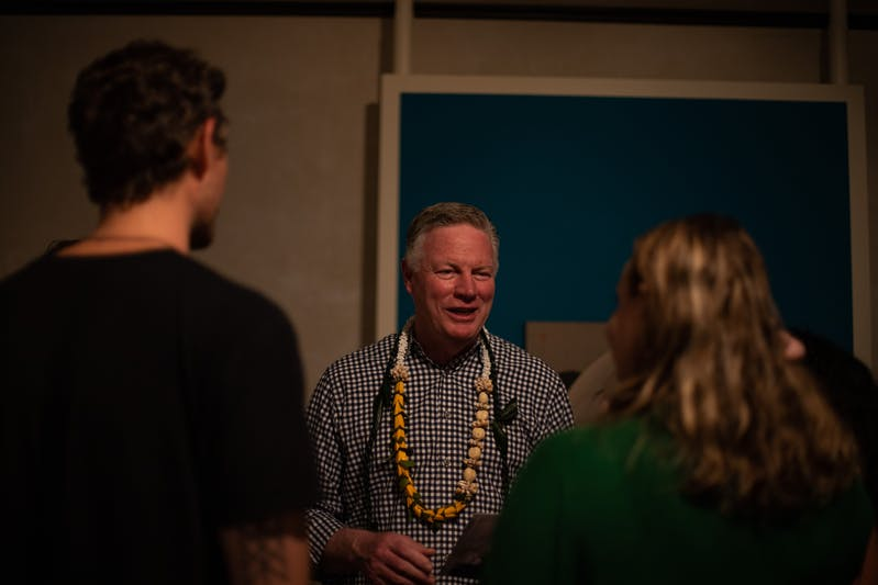 Ed Henry, President and CEO of the Doris Duke Charitable Foundation in conversation with attendees of the Hayv Kahraman exhibition opening at Shangri La
