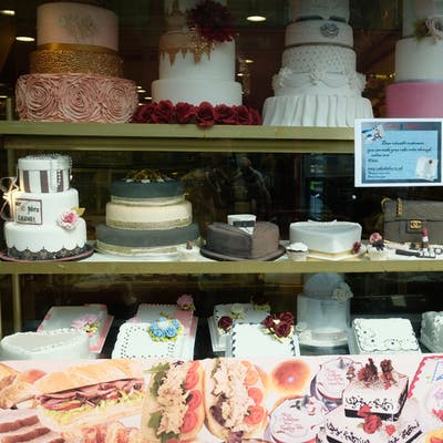 Cakes and Bakes shop window display - High Street North, East Ham