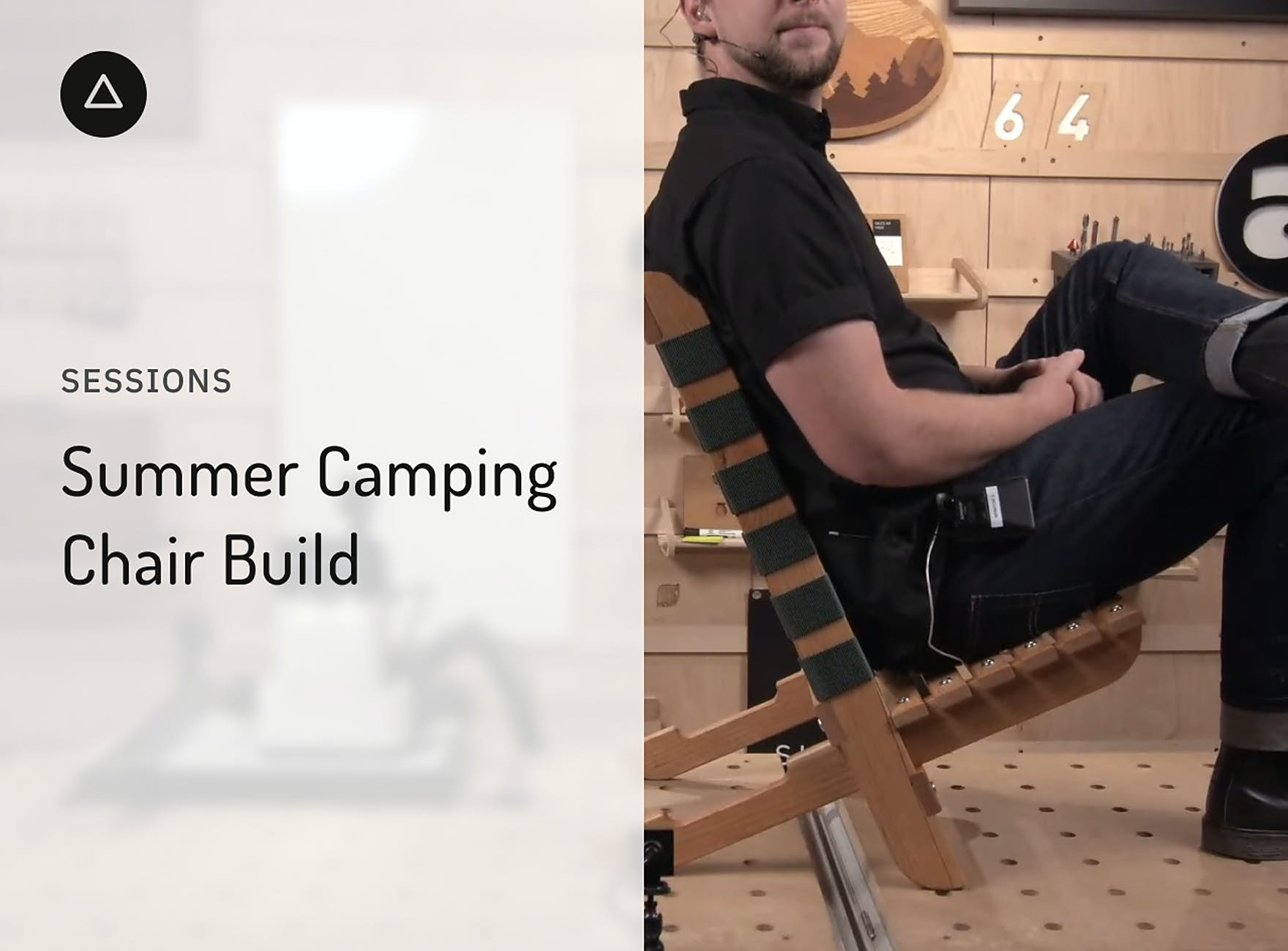 Jake sitting a a camping chair on top of a workbench