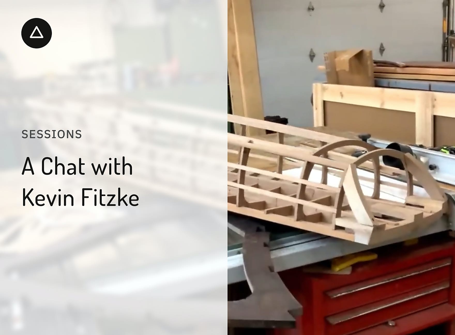 The frame of a wooden boat on a workbench