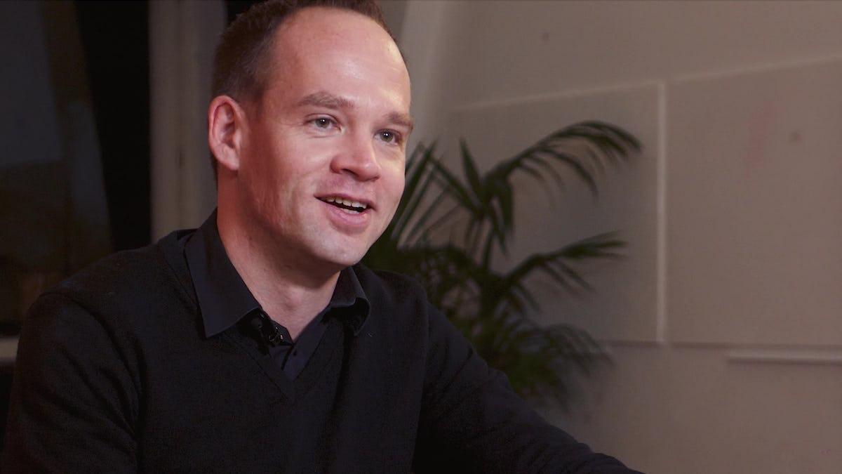 Makerist founder Axel Heinz in black shirt smiling