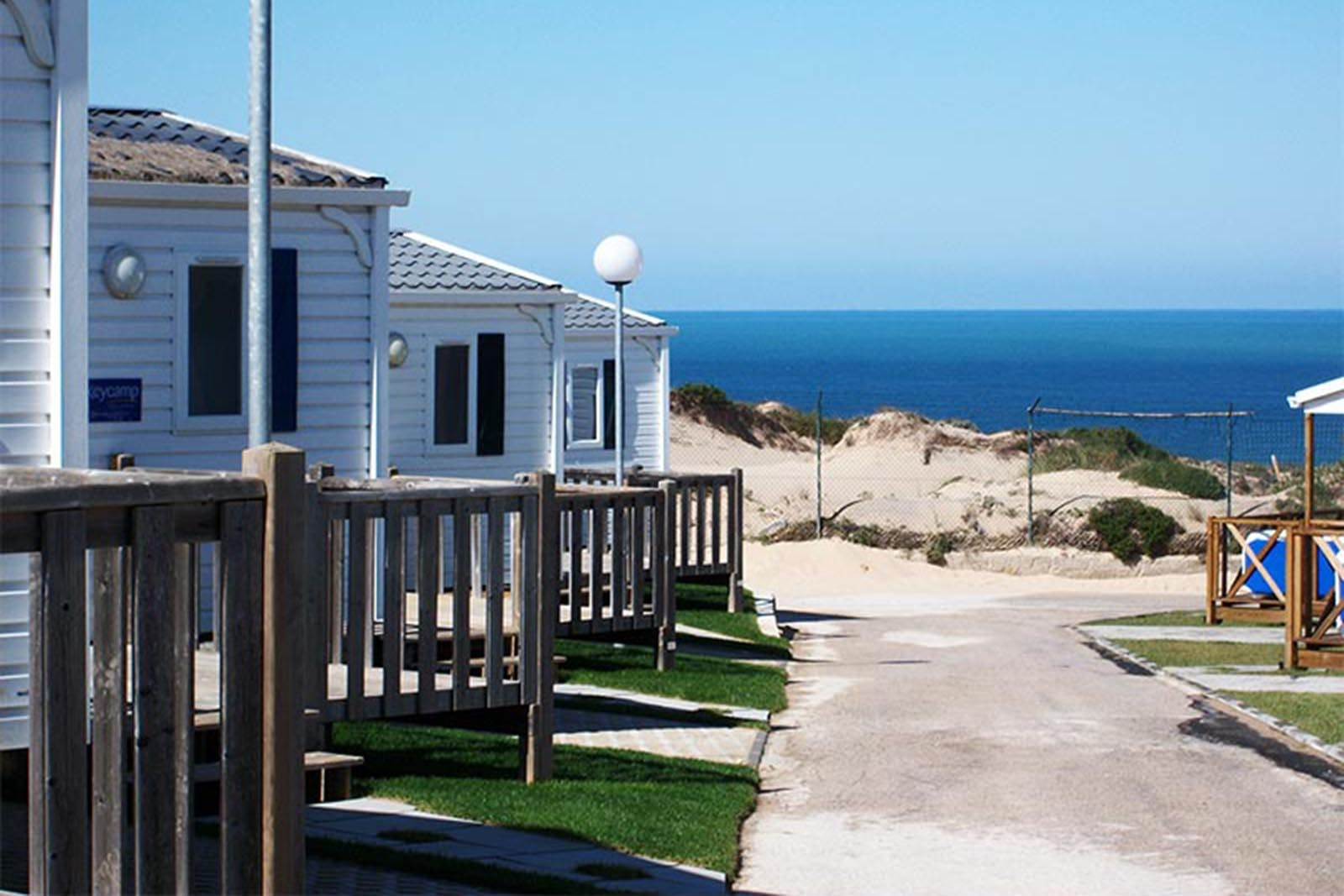 Campsite overlooking the Atlantic Ocean and Guincho Beach in Portugal.