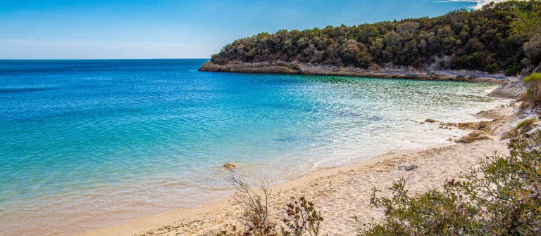 Quiet lagoon, calm, clear water of one of the best hidden beaches in Portugal.