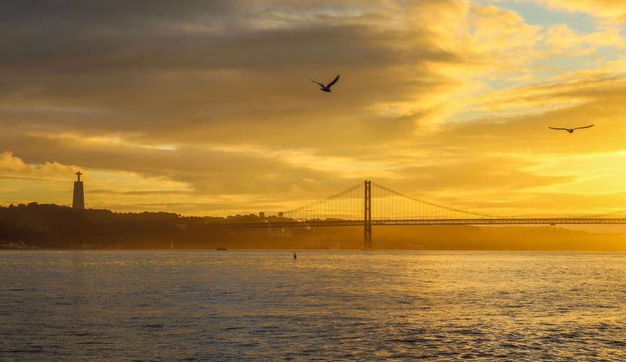 Sunset road trip drive along the Tejo river near Lisbon.