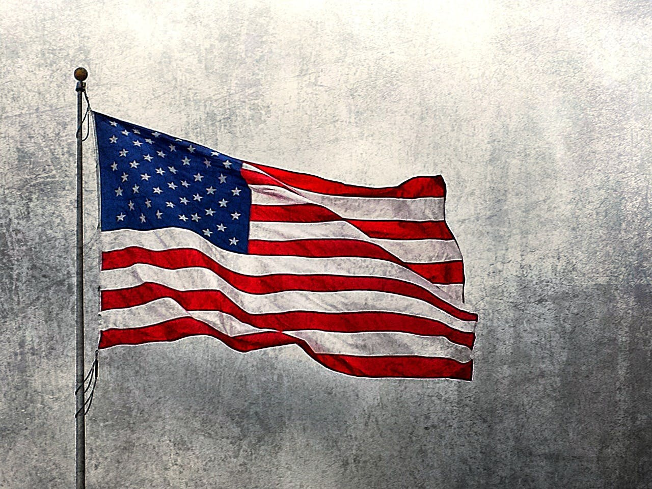A flagpole with an American Flag
