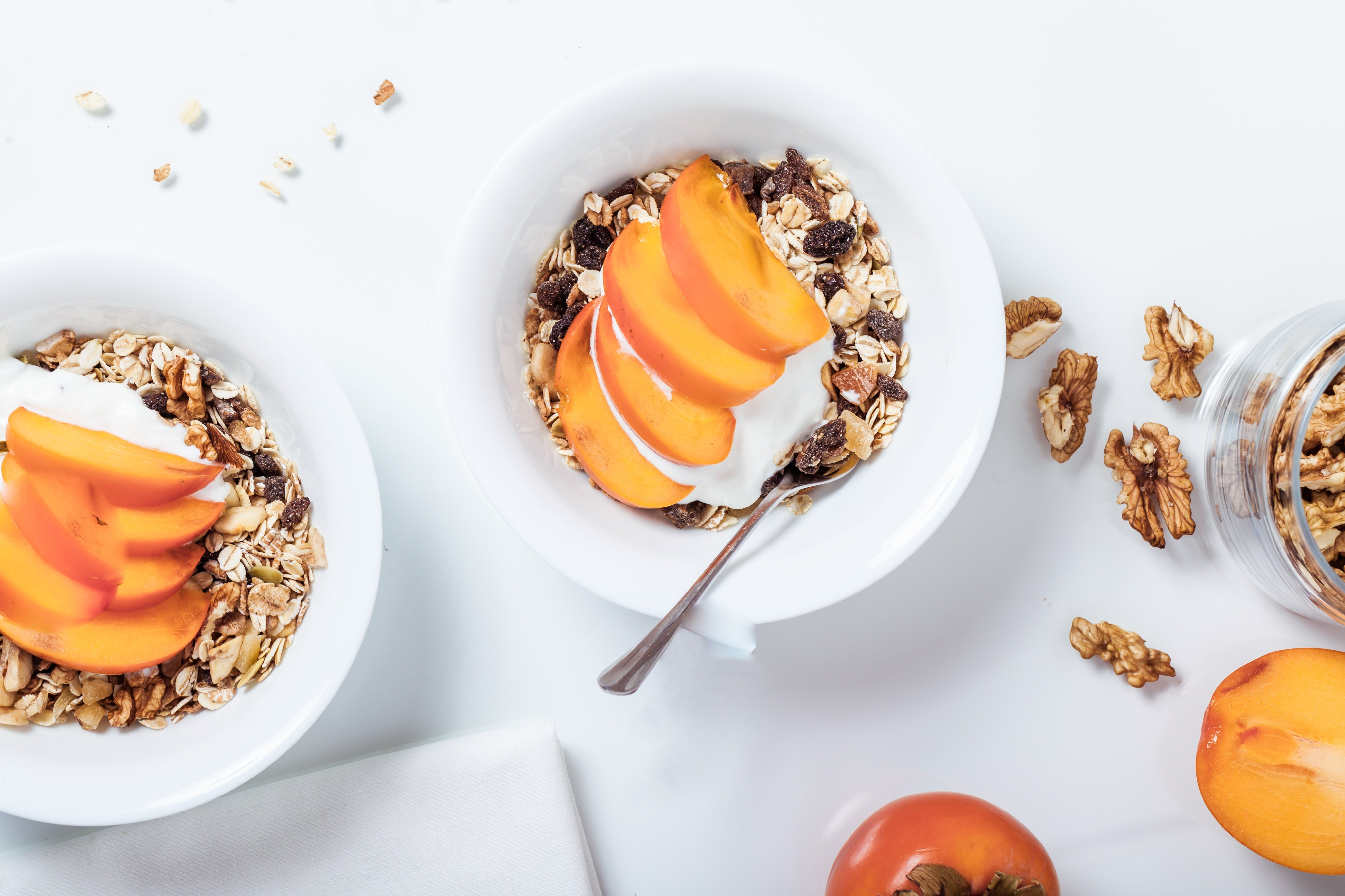 Two bowls with musli and fruit placed in a inspiring way