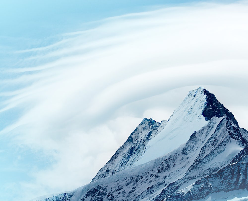 Lenticular clouds above a mountain top illustrate that Skydiamonds are made from the sky to protect the earth