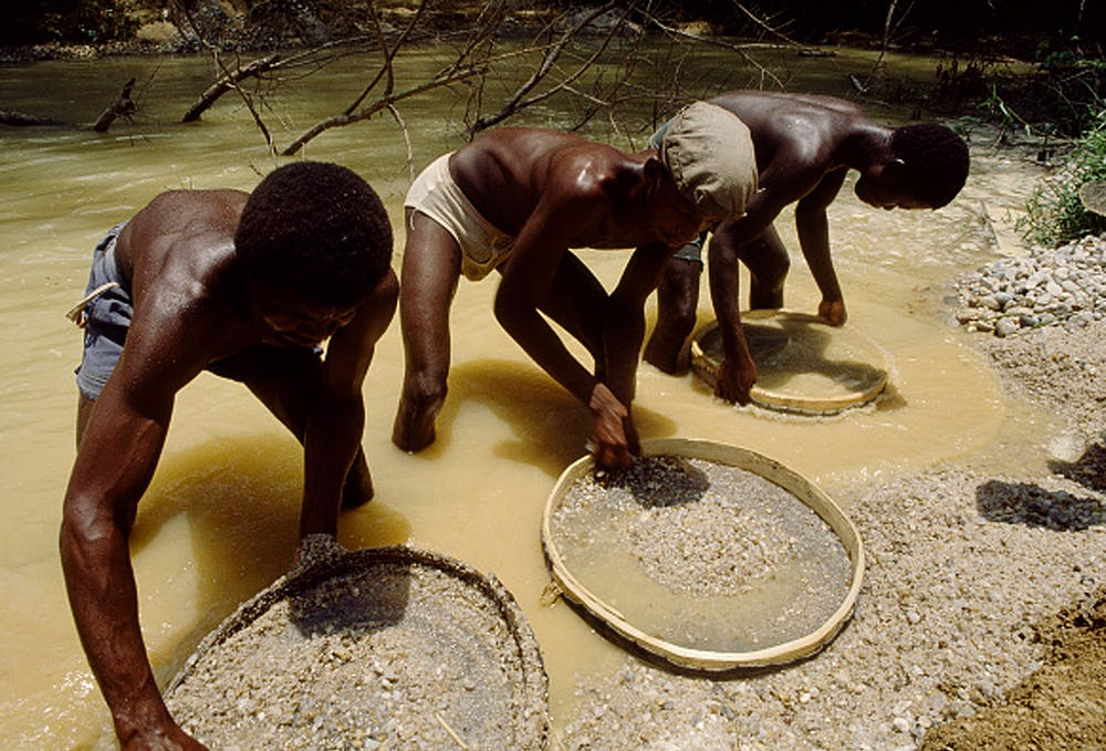 Three men panning for alluvial diamonds – Skydiamonds involve no worker exploitation