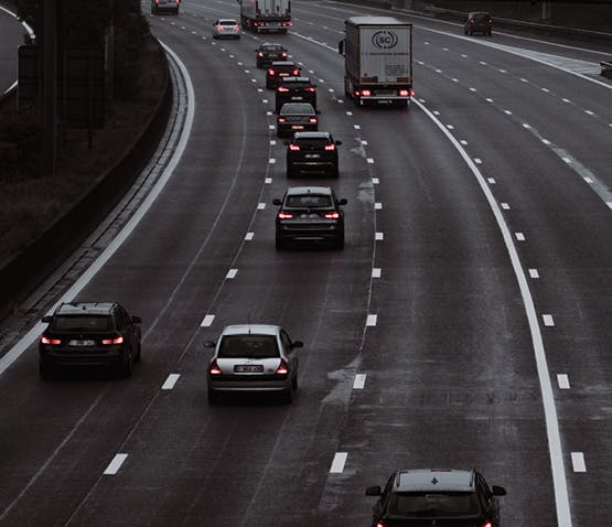 Motorway with vehicles depicting how IoT cars and roads will interface with each other.