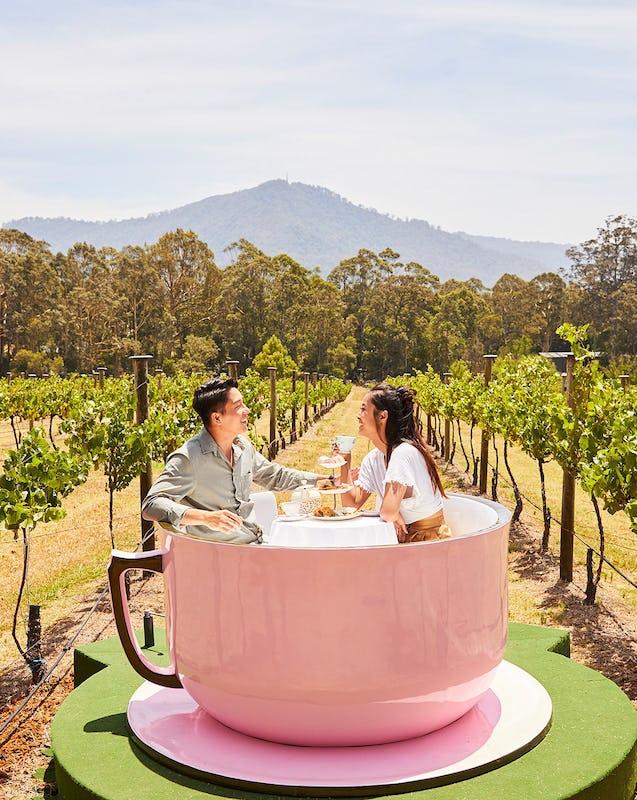 Couple enjoying a VIP High Tea Cup experience at Cambewarra Estate Winery, Bangalee.