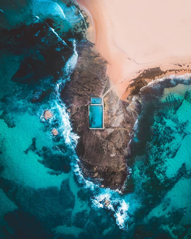 Mona Vale Beach captured by drone featuring rockpool