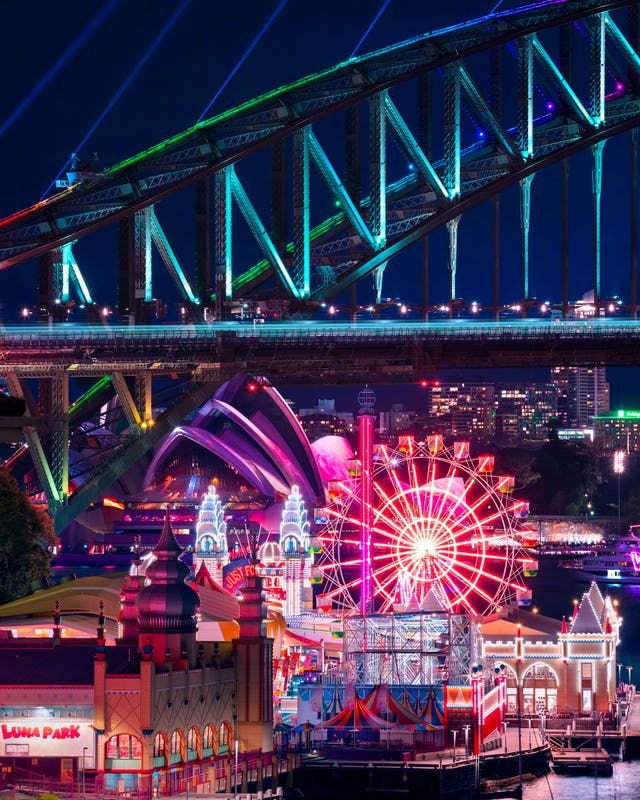 Vivid Sydney light installations captured from Lavender Bay featuring Sydney Harbour Bridge, Sydney Opera House and Luna Park Sydney