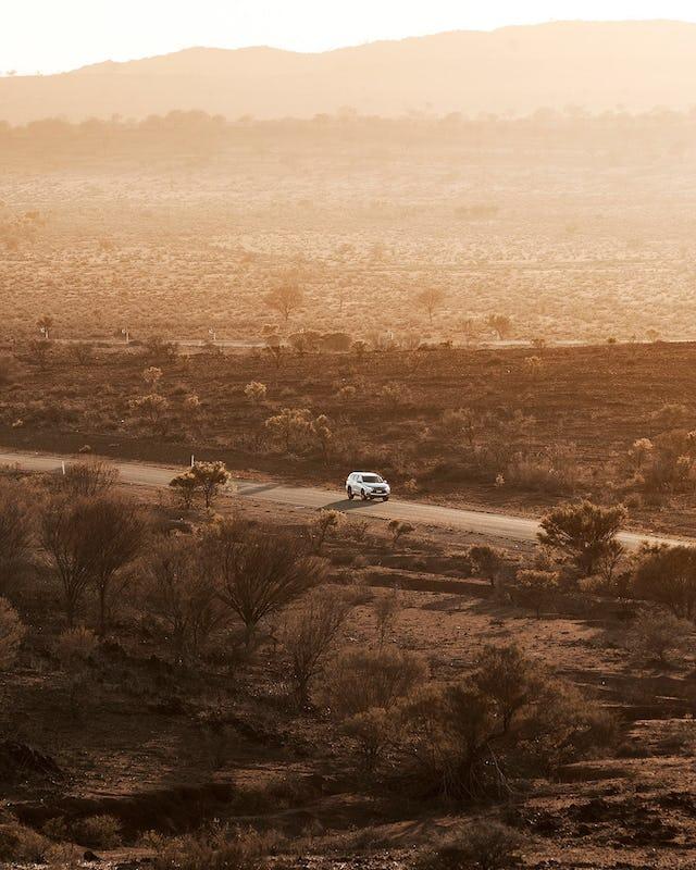 Car driving through the outback near Broken Hill.