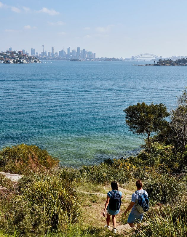 Couple enjoying scenic harbour views along the Hermitage Foreshore Track, Vaucluse.