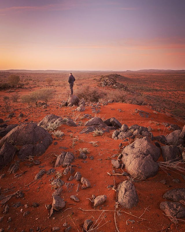 Man standing and overlooking Broken Hill countryside.