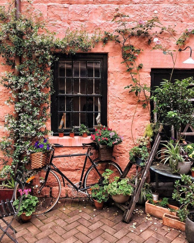 Bicycle in the courtyard of the La Renaissance Cafe in  The Rocks