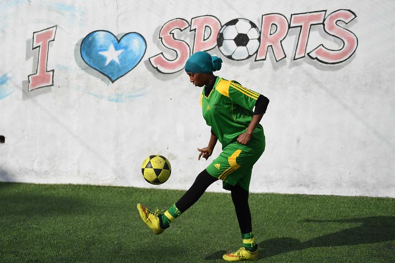 A female soccer player juggles a ball during a training session for Golden Girls Football Club in Mogadishu, Somalia on February 18, 2017.  (AMISOM). AMISOM Photo / Ilyas Ahmed