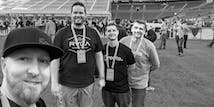 Some of the SoCreate Development Team are on the field of the Seattle Seahawks Stadium.