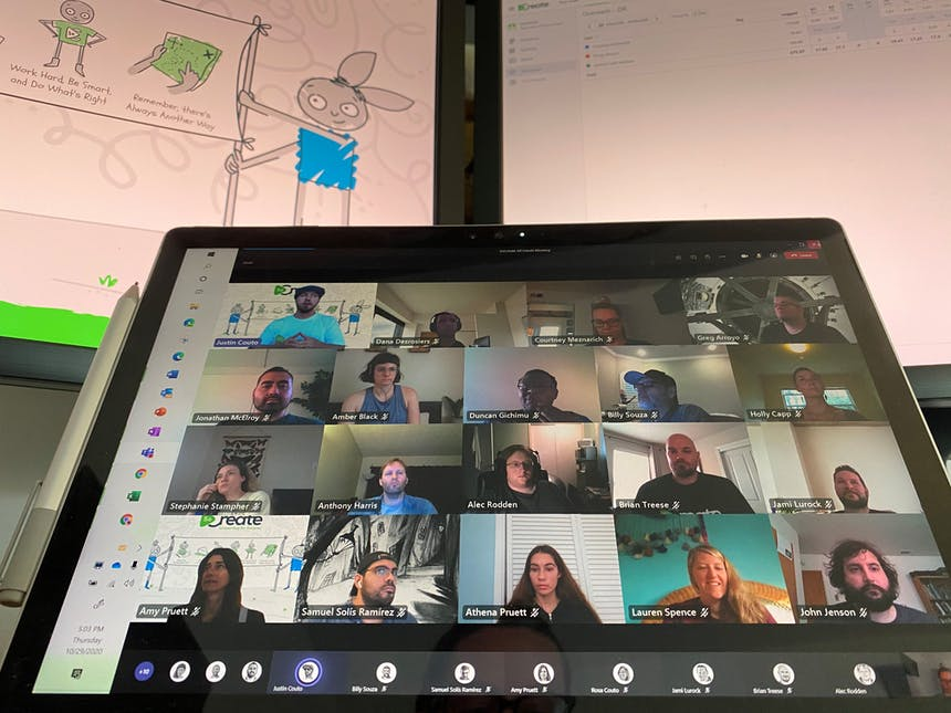 The SoCreate Team appears in a grid on a laptop screen for a virtual meeting