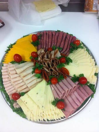 Deli tray of sliced meats and cheeses