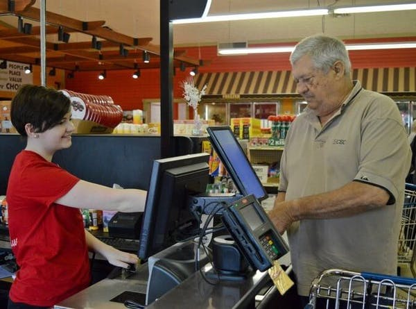 Sommers Market cashier checking out one of our customers at the register