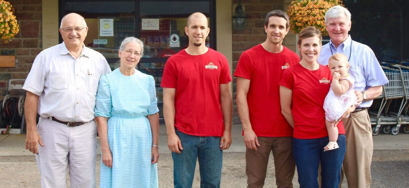 Roland and Dave Sommers, and family outside of Sommers Discount Market