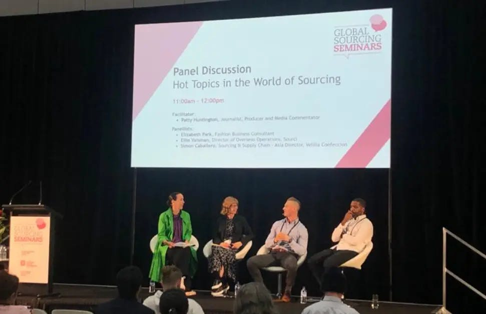 Image of speakers at a global sourcing seminar