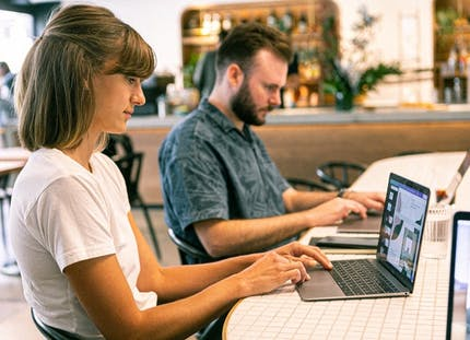 Male and Female office workers using laptops