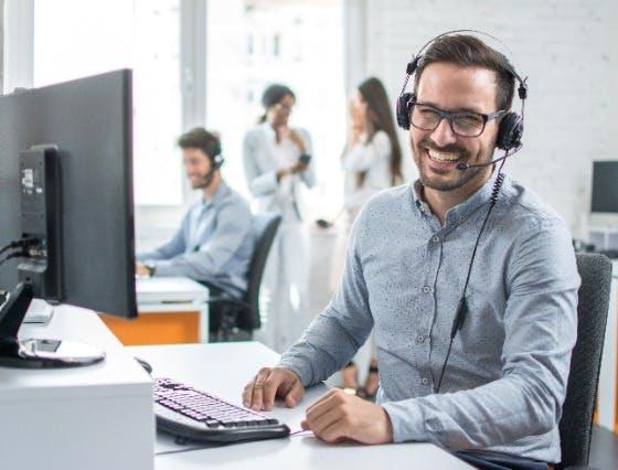 Smiling customer service representative on a call