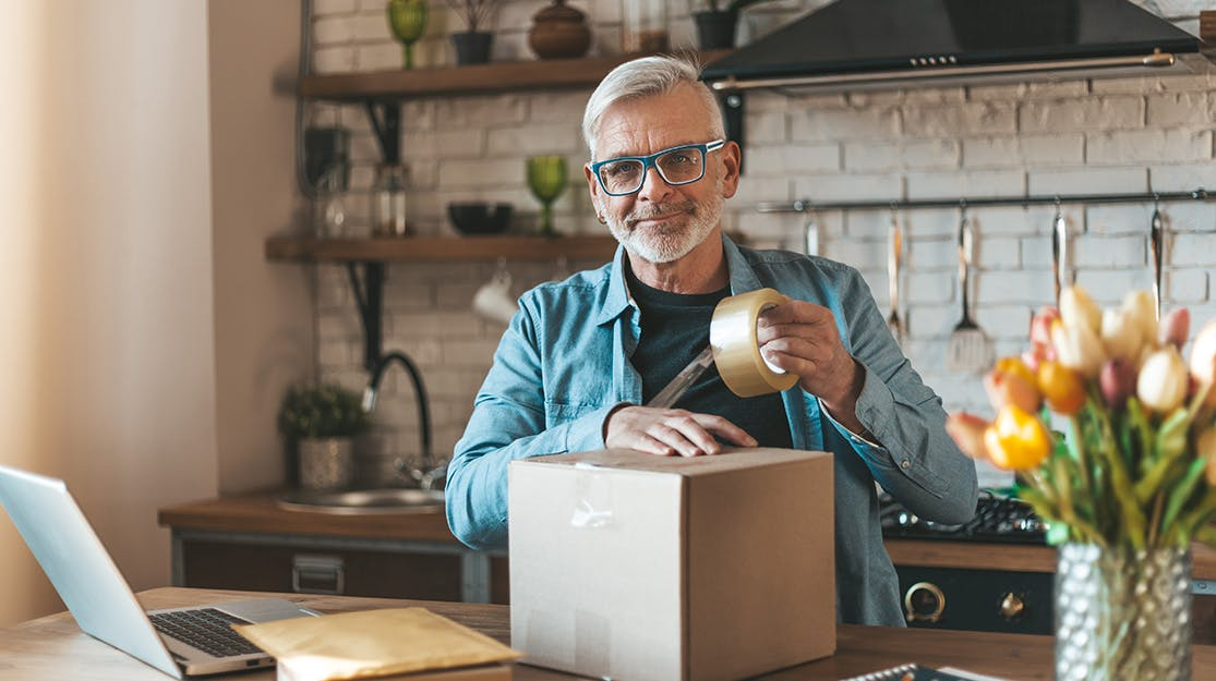Small business owner packing goods