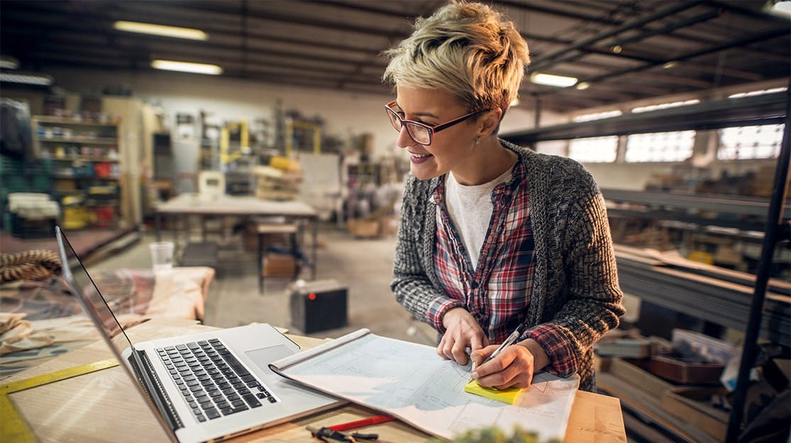 Woman using laptop at her small business