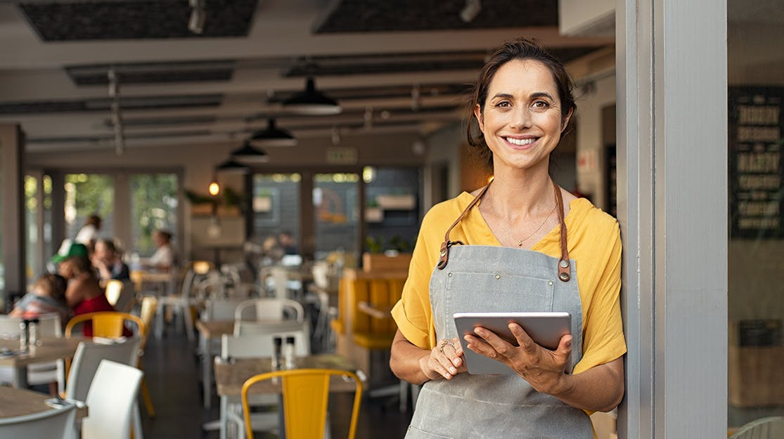 Lady with a tablet at her cafe