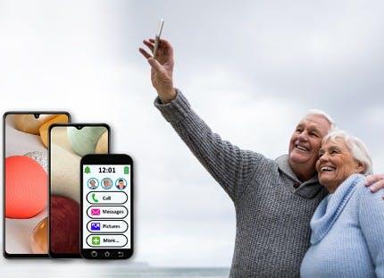 Seniors taking a photo on a phone