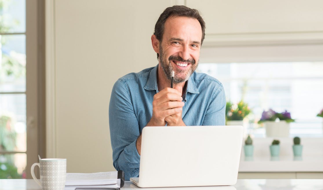 Man running small business from computer